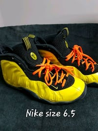 pair of orange-and-black Nike Foamposite Carvel, T0E 0H0