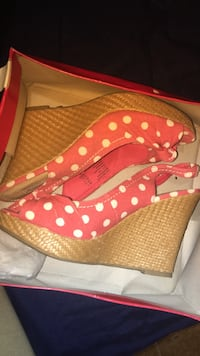 pair of women's red-and-white polka-dot slingback wedge shoes with box