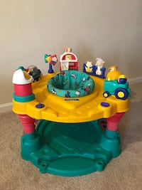 baby's yellow and green exersaucer