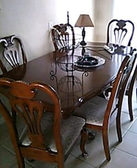 rectangular brown wooden table with four chairs di Stockton, 95204