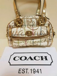 Gorgeous  coach  limited  edition  gold  bag  Whitby, L1N 8X2