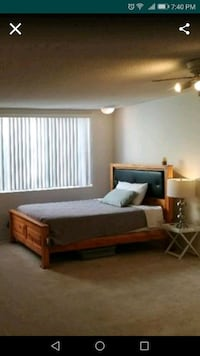 brown wooden bed frame and white mattress Los Angeles, 90001