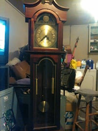 brown wooden granfathers clock