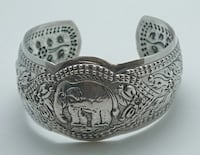 STERLING SILVER 925  BANGLE CUFF BRACELET WITH ELEPHANT DESIGN 35.4 GRAMS . PRE-OWNED. VERY GOOD CONDITION.  Baltimore, 21205
