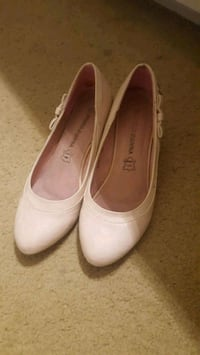 pair of white leather flats Mauldin, 29662