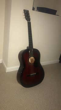 black and brown dreadnought acoustic guitar Rockville, 20853