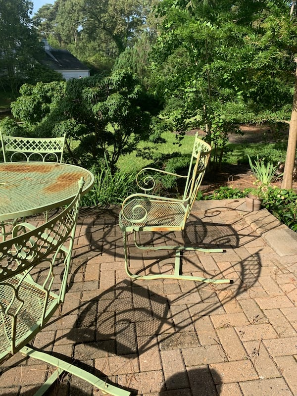 Vintage wrought iron patio outdoor table n 4 chairs 50+ yrs old. c2551a4d-fb24-43b3-ae85-0252a6cbe4af