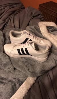 pair of white-and-black Adidas Superstar Fairplay, 21733
