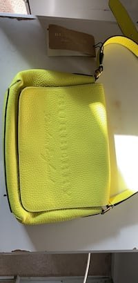 yellow and black leather bag 46 km