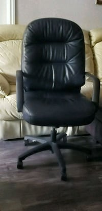 black leather office rolling armchair Houston, 77081