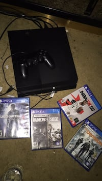 Black sony ps4 console with controller and games Houston, 77016
