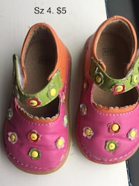pair of pink-and-green Crocs clogs 21 mi
