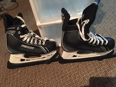 pair of black-and-white figure skate