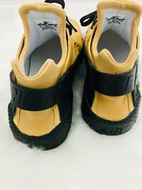 Size 10 gold and black custom huaraches  Fayetteville, 30215