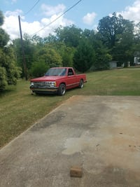 red Chevrolet S-10 single cab