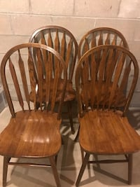 two brown wooden windsor chairs 299 mi