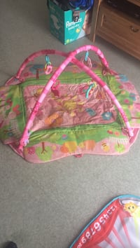 Baby's pink and green activity gym