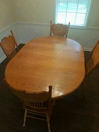 oval brown wooden table with four chairs dining set Riverdale, 30274
