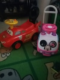 red Lightning McQueen and pink Minnie Mouse ride-on toys Springfield