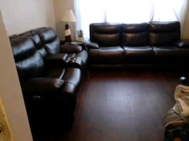 NEW LEATHER ASHLEY LIVING ROOM SET THAT RECLINES ON EACH SIDE