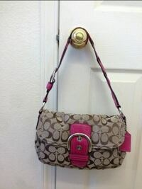 Pink and brown Coach purse 2345 mi