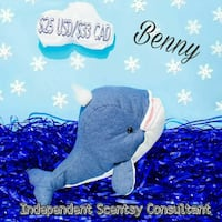 blue and white dolphin plush toy