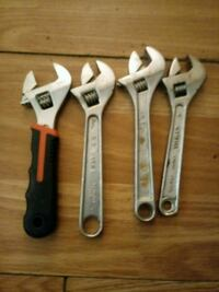 4 adjustable wrench one of them's smk Wayne Concord