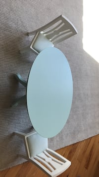 round white wooden table with chairs