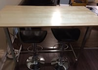 rectangular brown wooden table with four stools Toronto, M6G 1X5
