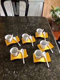 Espresso cups, saucers and spoons.
