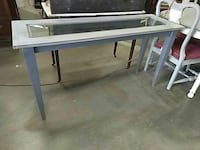 rectangular glass top table with gray metal base