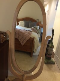 Brown wooden framed cheval mirror. About 5.5 feet high.  Glass is perfect just one surface mark about an inch long.  No cracks Herndon, 20170