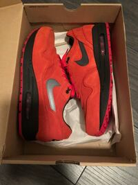 pair of red Nike running shoes with box Homestead, 33033