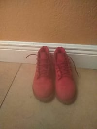 pair of red leather work boots