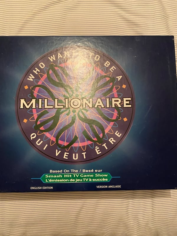 Who Wants to be a Millionaire Board Game bf55a07a-518e-447c-81d3-4165624379df
