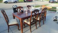 rectangular brown wooden table with four chairs di Murrieta, 92563
