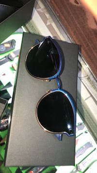 blue sunglasses with black frames 786 km