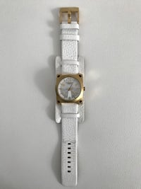 round gold analog watch with white leather strap Laval, H7X 3R6