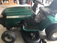 green and black Ranch King riding mower