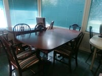 rectangular brown wooden table with six chairs dining set Pineville