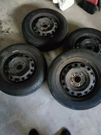 black bullet hole car wheel with tire set Mississauga, L5B 0B4