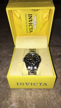 Round black invicta analog watch with silver link bracelet New York, 11357