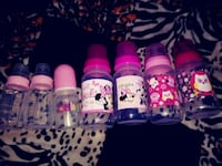 four assorted color nail polish bottles