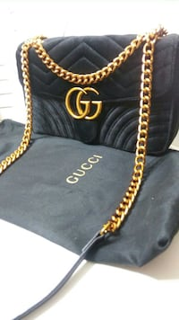 women's black Gucci suede sling bag