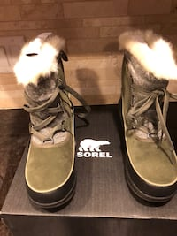 pair of gray Sorel suede fur-lined boots with black box