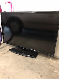 black flat screen TV with remote Murrieta, 92562