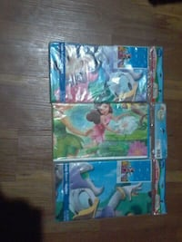 Tinker bell, mickey mouse table cloth 5$ each  Bloomington, 92316