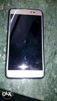 white android smartphone with black case Lucknow, 226010