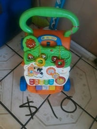 baby's green and yellow learning walker