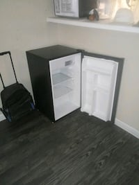 two black and white wooden cabinet Houston, 77031
